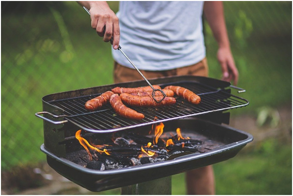 sausage on grill in open